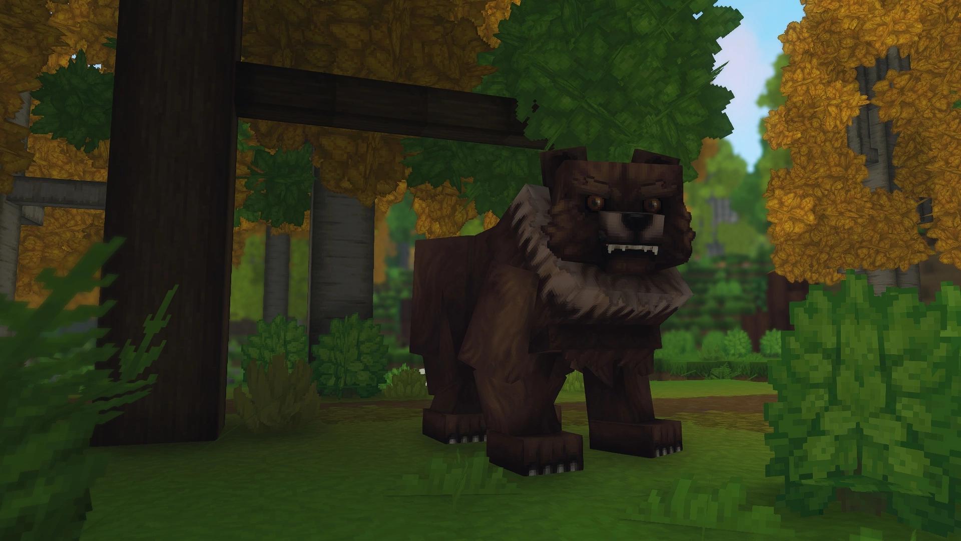 Un Grizzli au premier plan qui est en train de nous fixer l'air menaçant.
