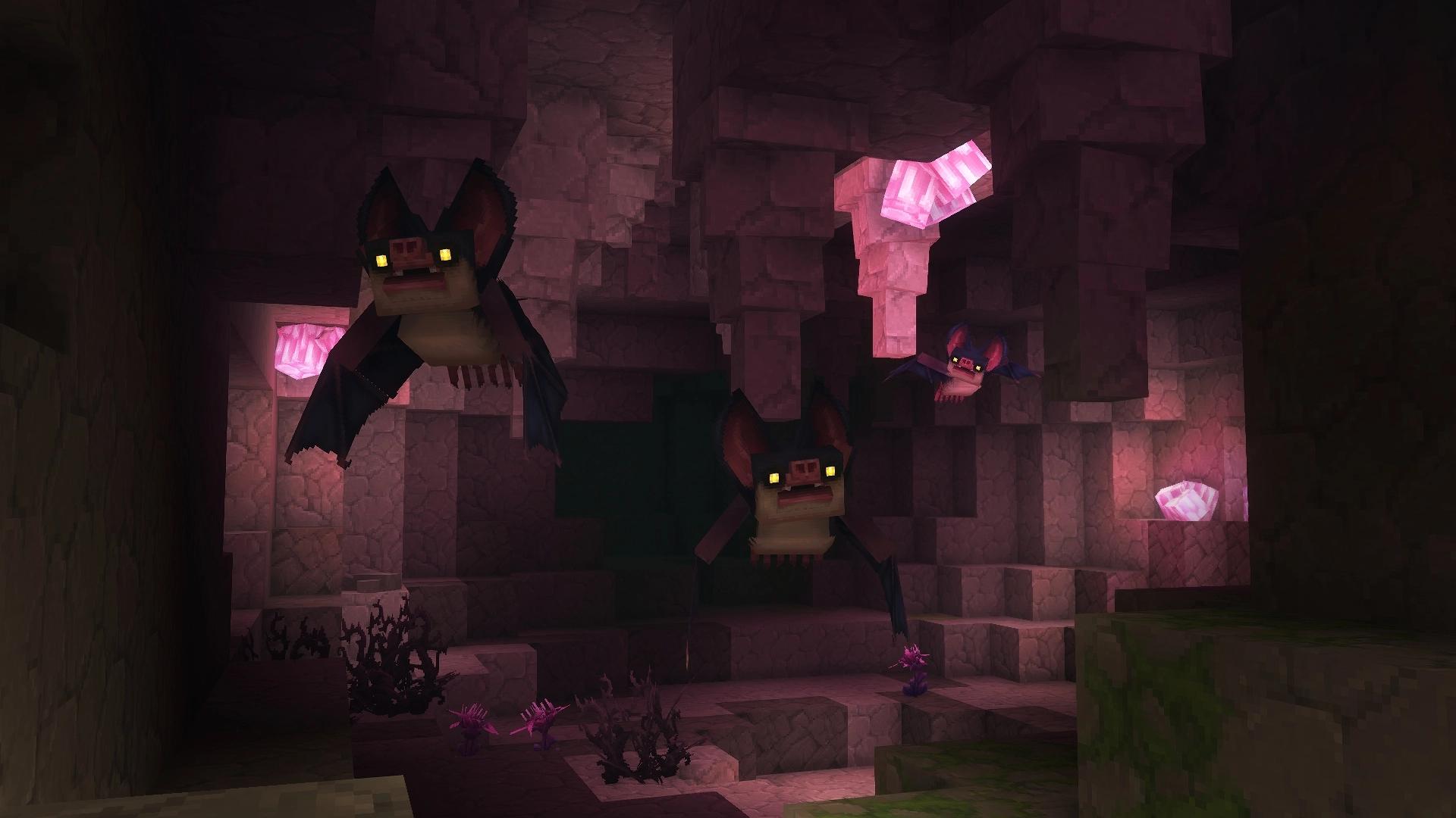 Des chauves-souris volent en groupe dans une grotte éclairée par des minéraux roses.